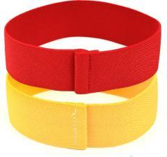 Särmä hihanauhat, punainen ja keltainen
